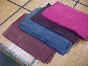 assorted colors of suede leather pieces for sale by the piece