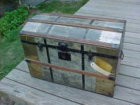 Metal covered antique trunk