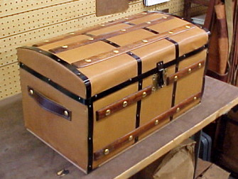 Refinished leather covered small trunk