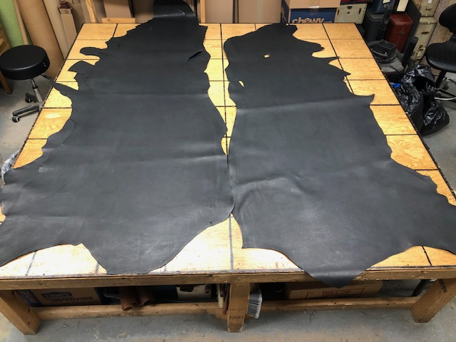 Thick              black leather hides for sale