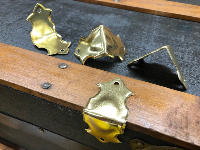 Brass trunk hardware, edge clamps, corner guards