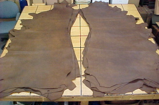Brown leather hides for making quivers