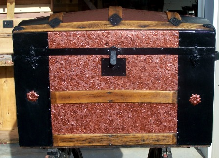 Refinished antique pressed metal trunk