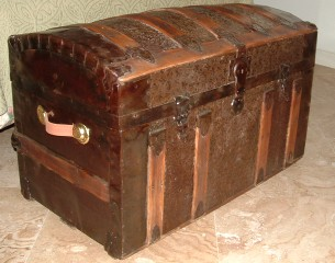 Refinished antique metal clad trunk