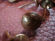 Antiqued upholstery tacks
