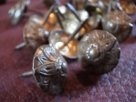 Decorative tacks for antique trunk repair and refinishing