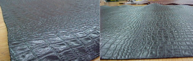 Black leather hides embossed with a crocodile pattern