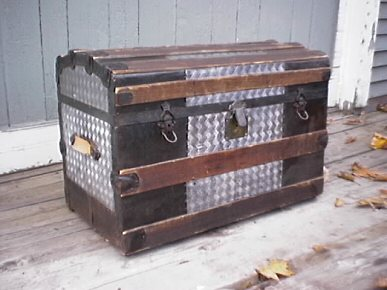 Restored antique metal trunk