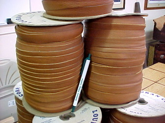 Spools of leather stripping