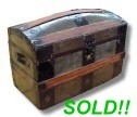 Metal dome top antique trunk for sale