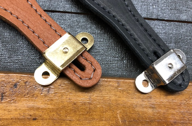 Handle brackets for instrument cases and suitcases
