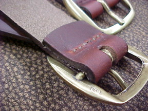 trunk straps with stitched leather and brass buckles