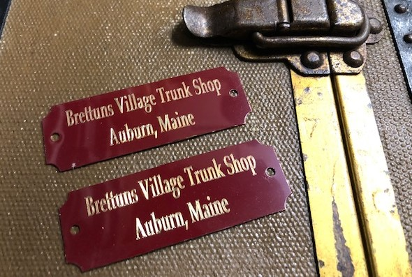 Metal trunk tags with trunk maker name