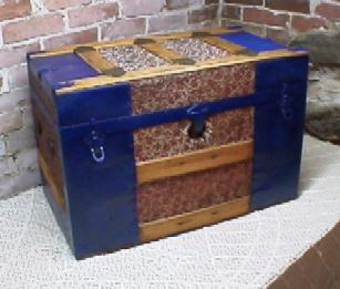 Fancy metal trunk refinished by Brettuns Village
