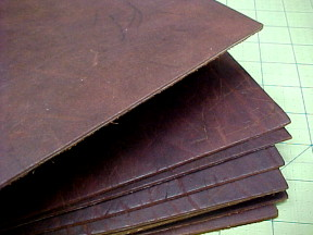 deep reddish brown leather hides on sale
