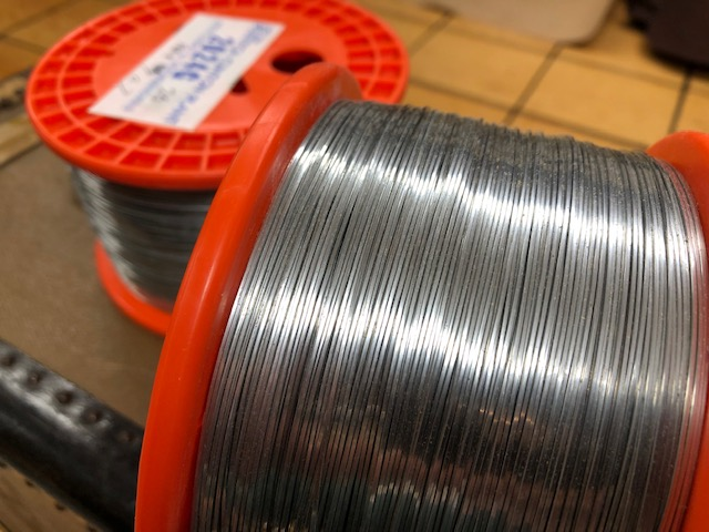 Book binder's wire on spools