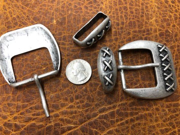 3 X belt buckles