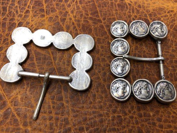 Coin motif belt buckles