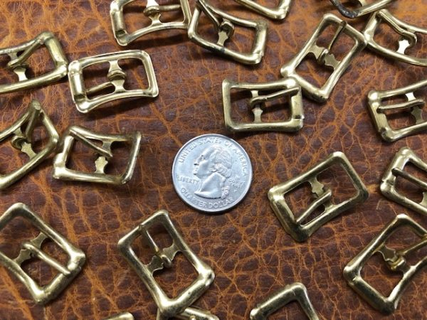 small brass strap or collar buckles