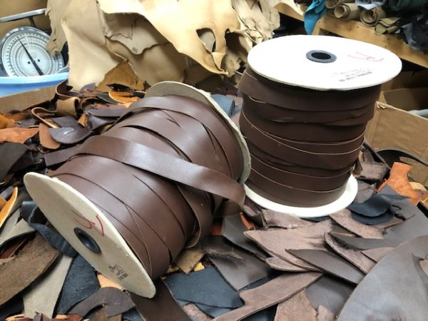 brown one inch wide leather ribbon on spools