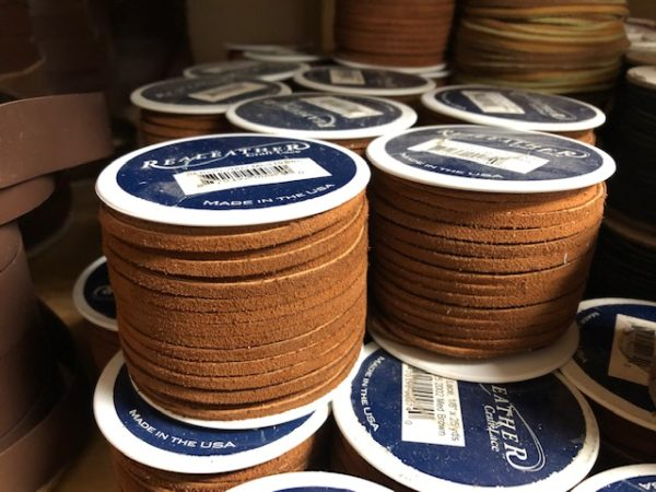Spools of medium brown leather lacing for sale