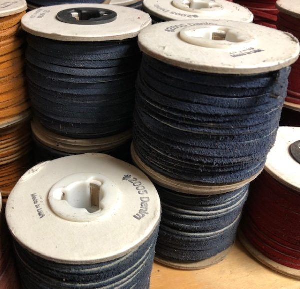 Spools of navy blue leather lacing for sale