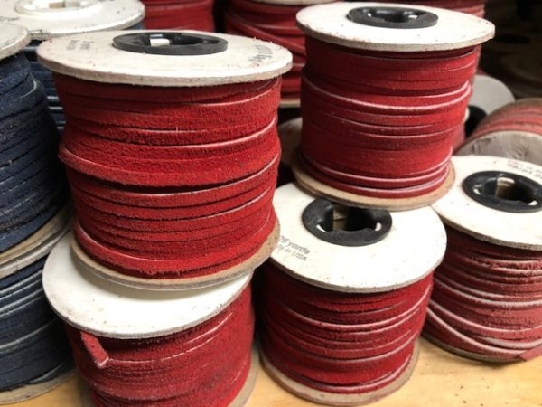 Spools of red leather lacing for sale