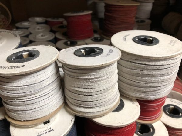 Spools of white leather lacing for sale