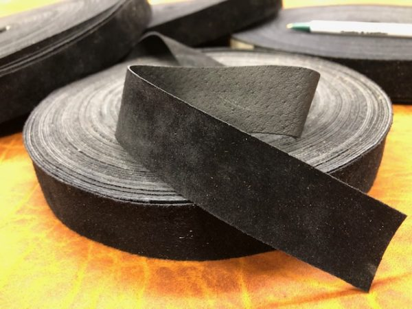 close up of black suede leather ribbon
