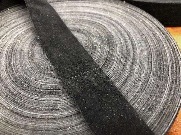 close up of seam in black suede ribbon