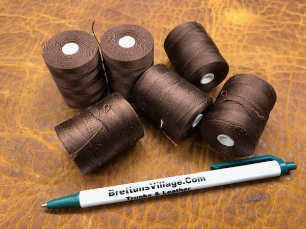 dark brown dacron thread on small spools