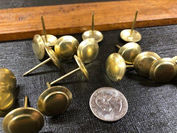 Brass buttons for trunk repair