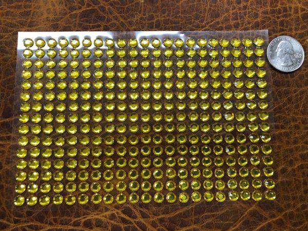 315 little golden clear gemstones