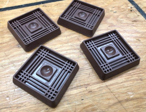 steamer trunk wheel cups to protect floors