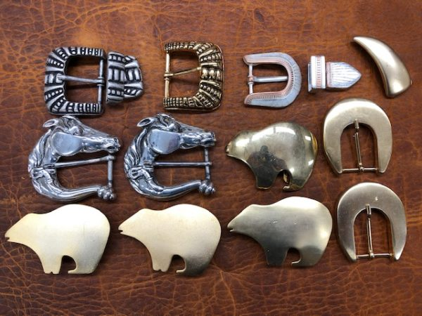 collection of fancy belt buckles