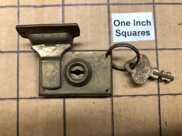 Very small vintage case lock with key