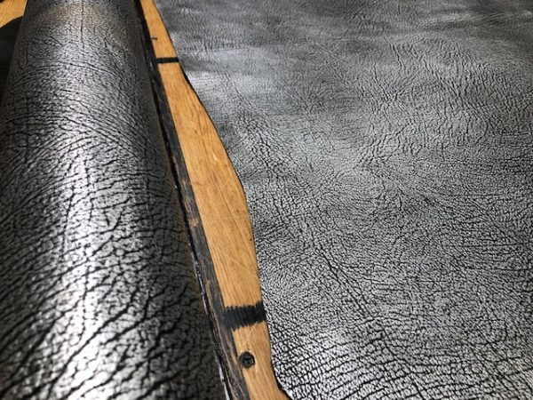 Metal Tembo is a textured metallic cowhide side printed with a metallic elephant skin pattern!