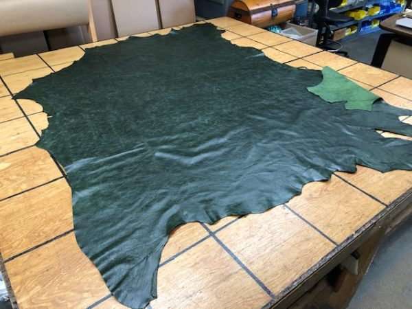 Dark Green hide is soft leather for garments or upholstery work