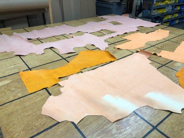 Panels and Partial Hides of Orange, Pink, Pinkish-Orange, and Orangey-Pink Nubuc Leathers
