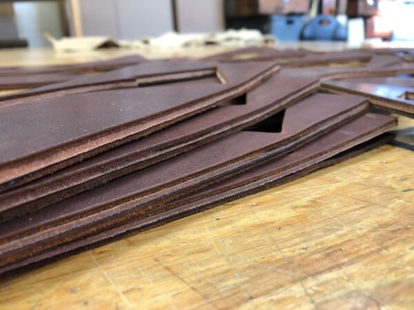 Leather Hide Clearance Sale 195 is a Set of 25 pieces of 16 oz Laminated Harness Leather in WigWam Red-Brown