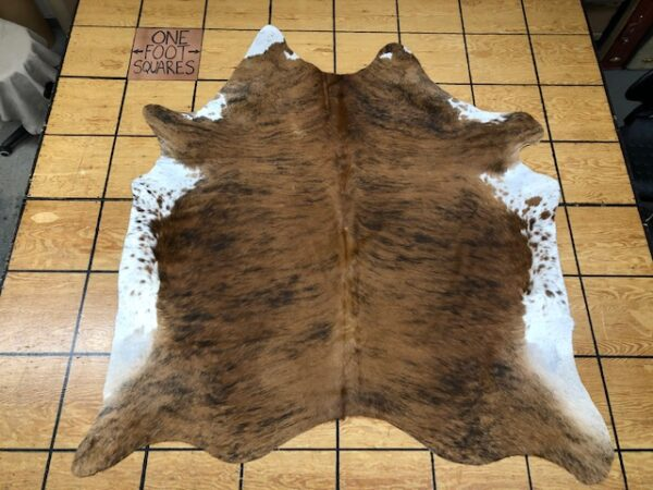 Hair On Cowhide 221 is a shade of brown that's almost orange - tanned and finished in Brazil with free USA shipping